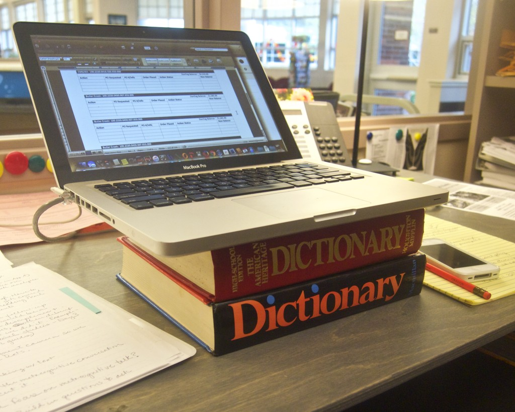 laptop on dictionaries